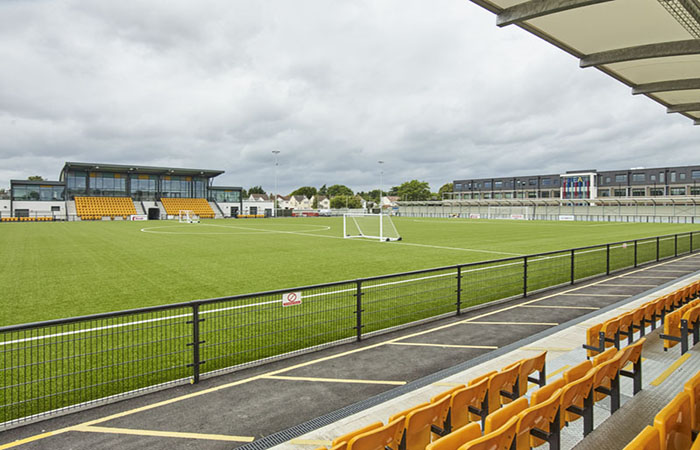 Stadium seating and pitch at Arbour Park